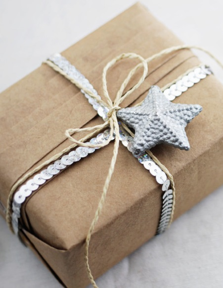 gift wrapped in brown paper and silver ribbon