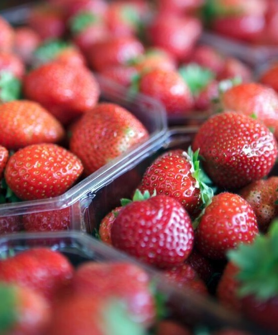 punnets of strawberries on stall