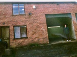 man outside empty warehouse
